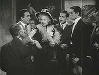 Alice Faye (centro) con Jack Haley (izq.), Don Ameche, y Tyrone Power (der.), en Alexander's Ragtime Band (1938)