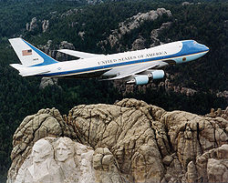Air Force One flying over Mount Rushmore.